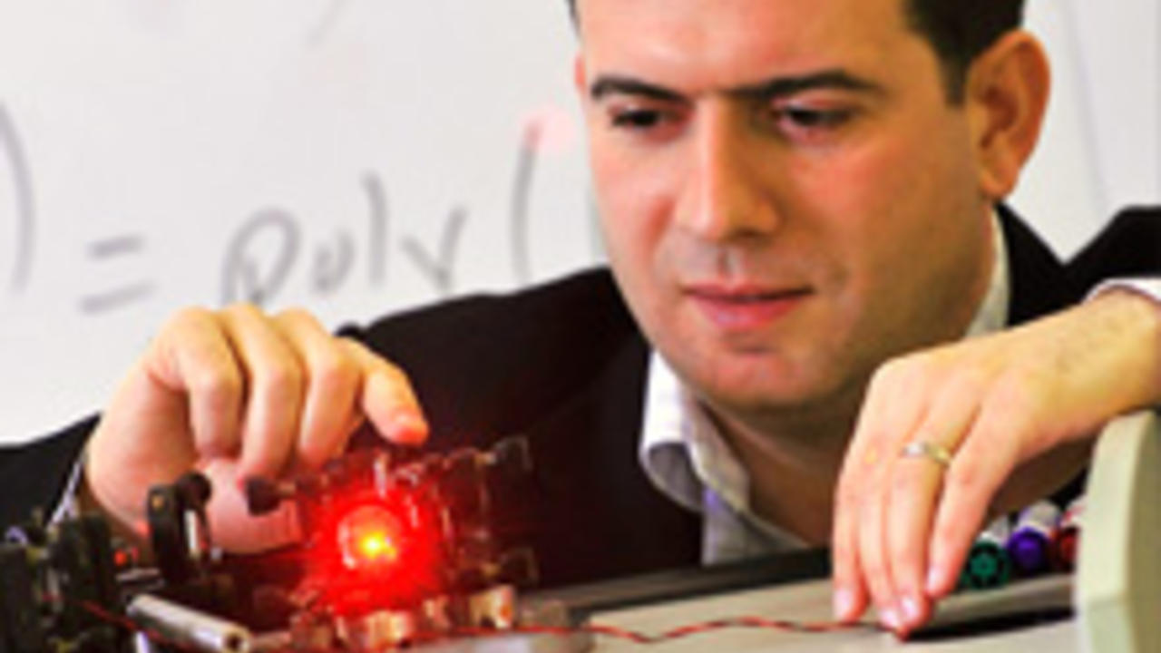 Michele Mosca conducting an optics experiment
