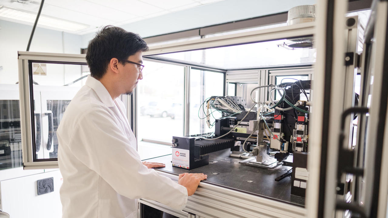 student using a 3-D printer