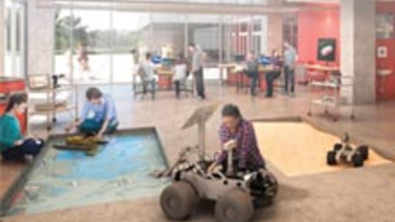 Eng students work with robots