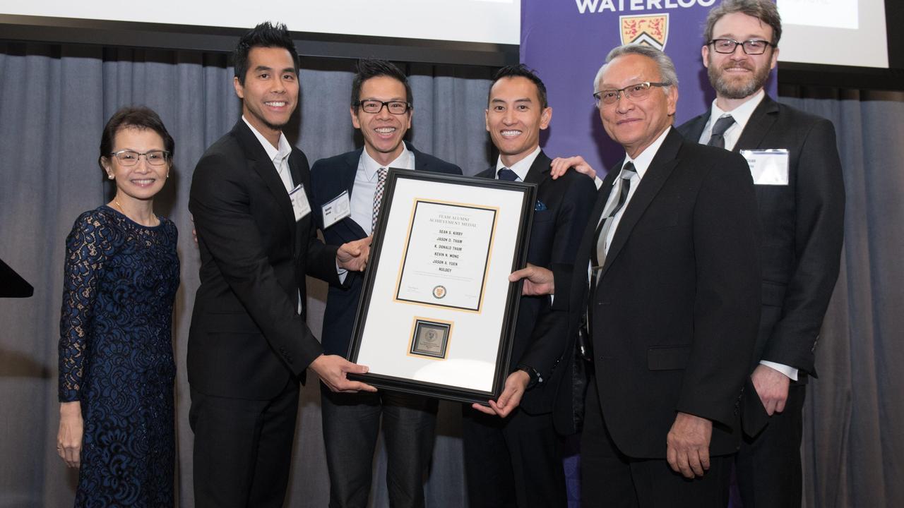 The Nulogy team accept their award with Dean Pearl Sullivan