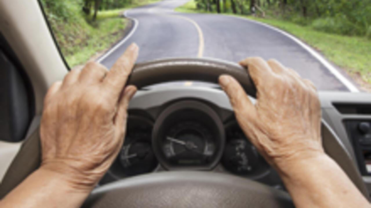 Senior driving a car