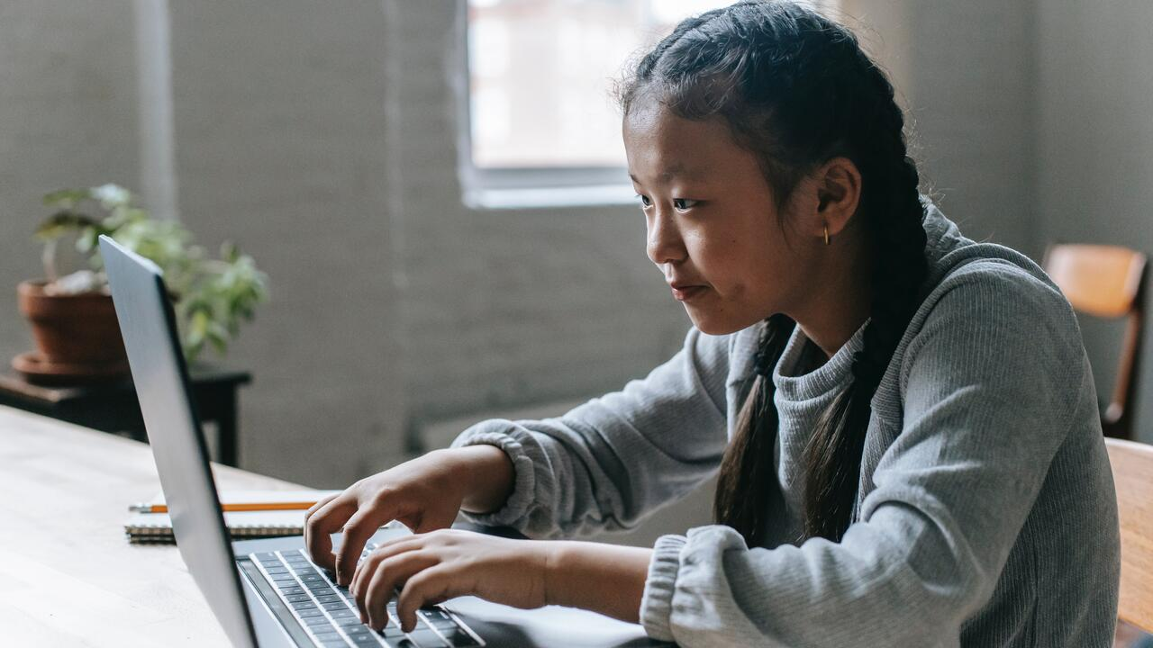 A girl works on a computer.