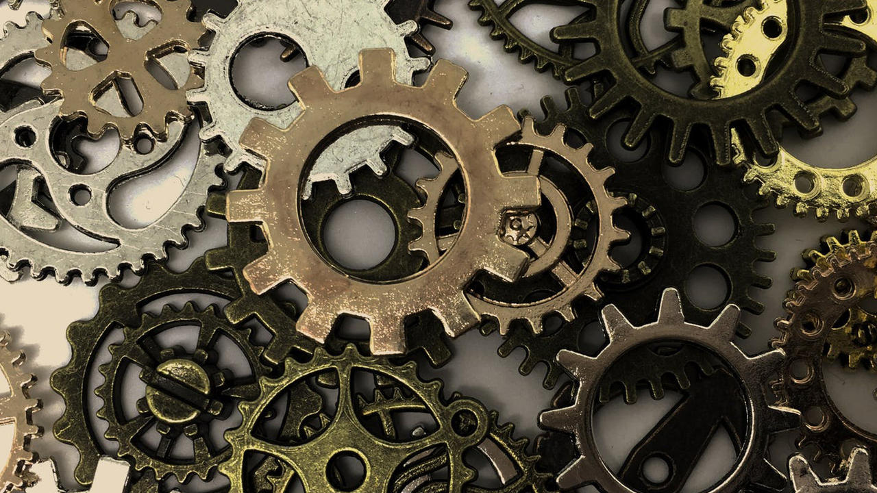 Random gears scattered on flat surface