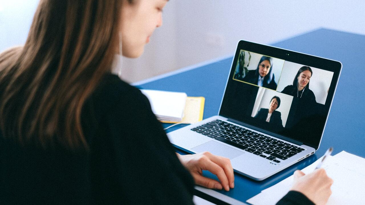 Some on a video call with four other people