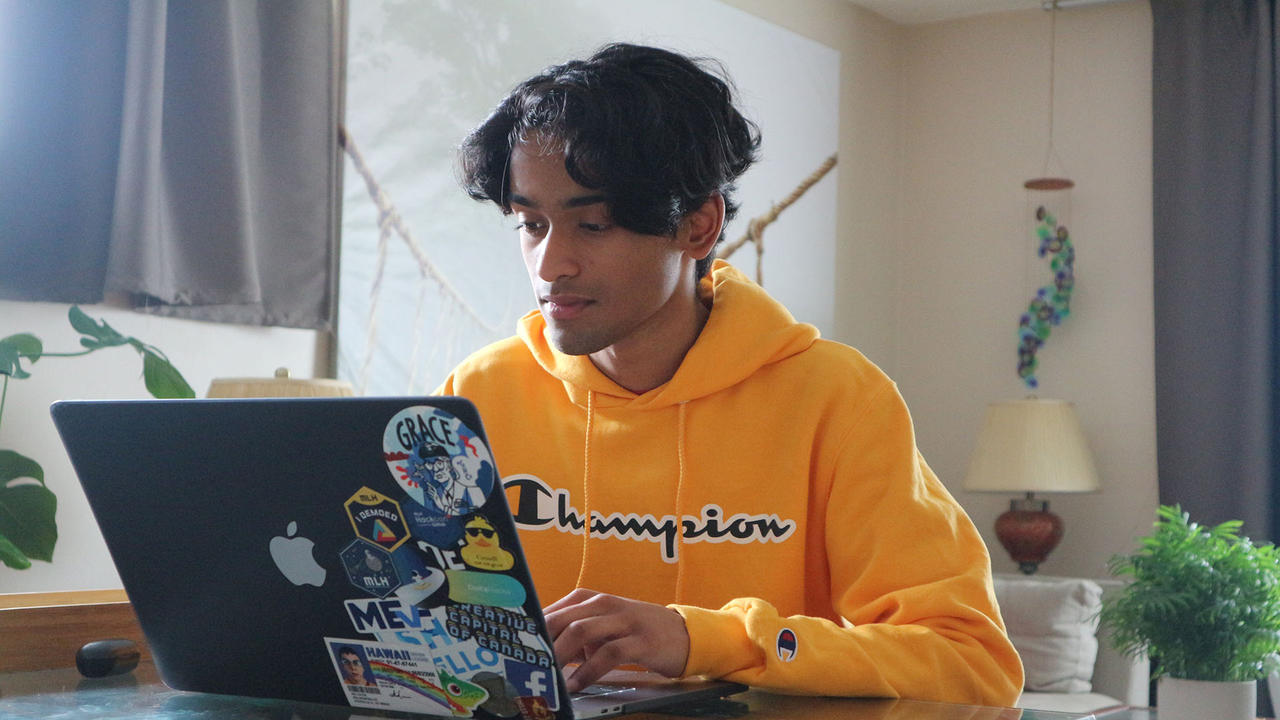 Student at desk on computer