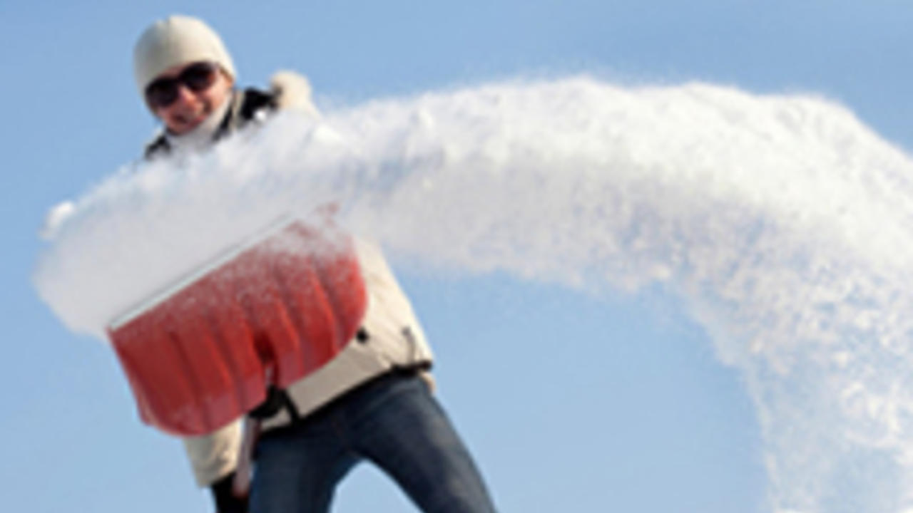Woman shovelling snow