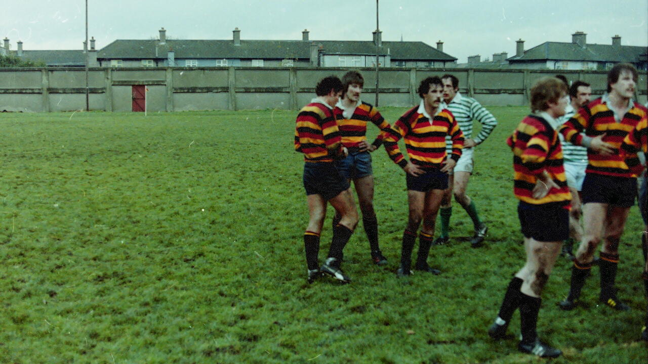 Stephen Webb on a rugby field with teammates