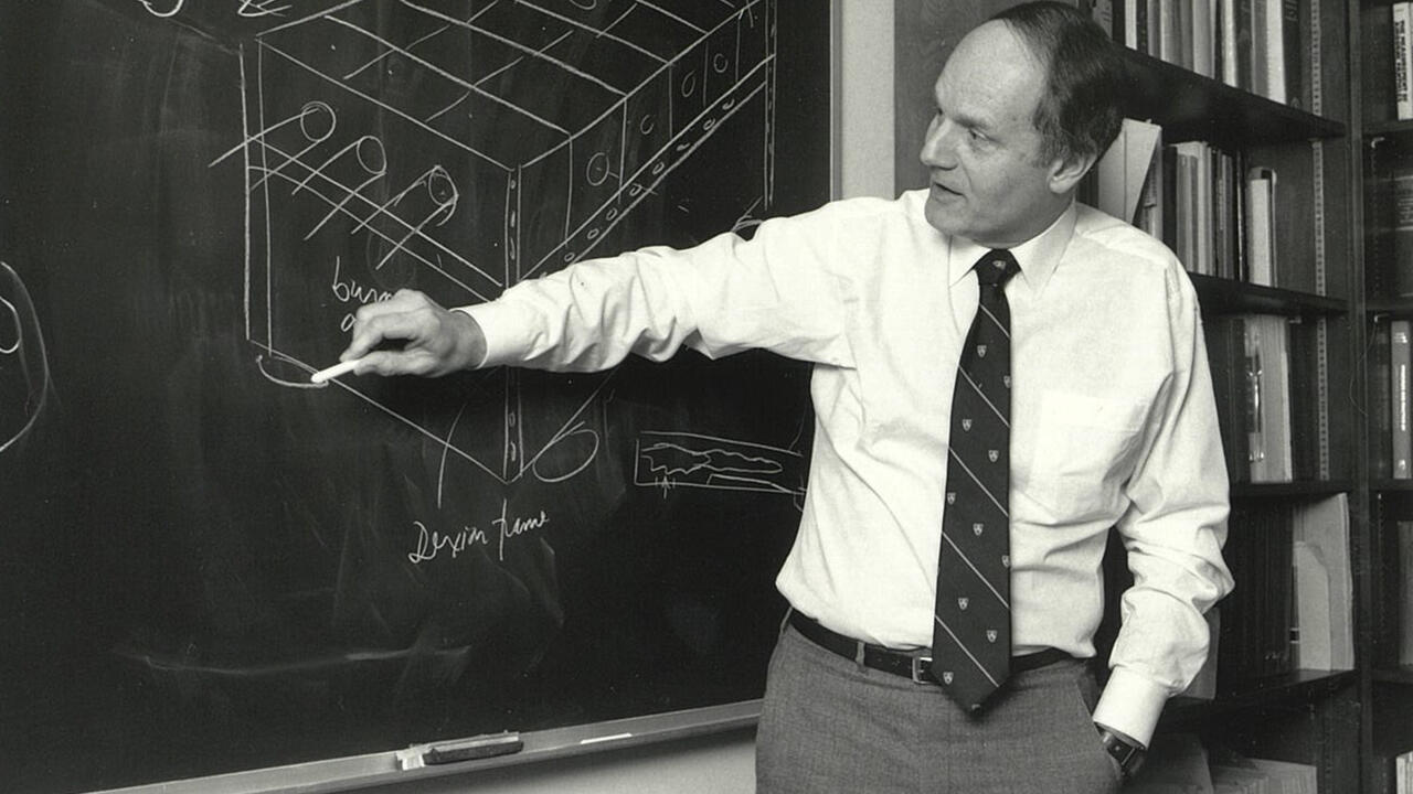 Thomas Bzrustowski lecturing in front of a blackboard