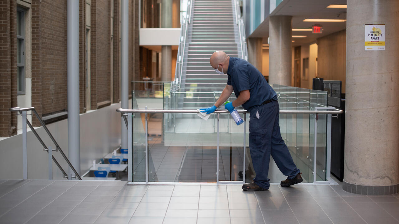Maintenance worker cleaning campus