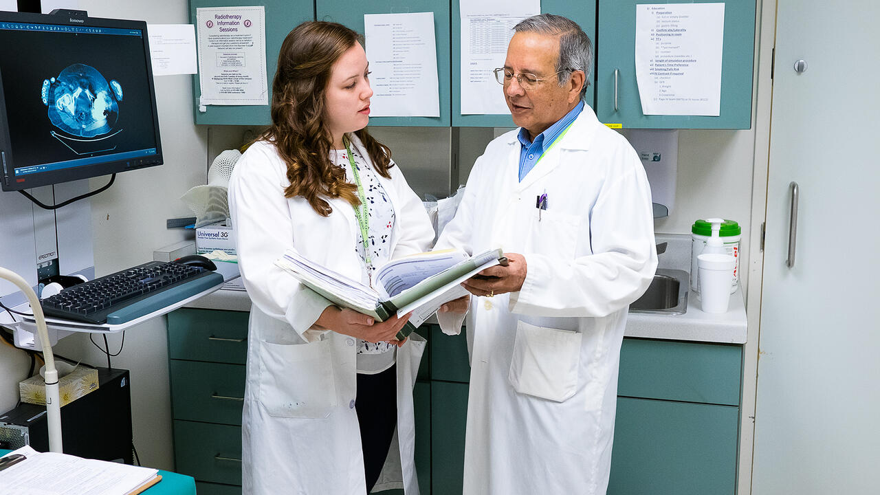 Co-op student speaking with doctor