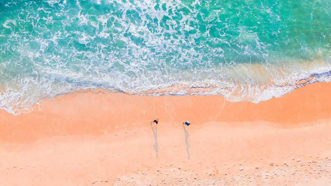 Aerial view of sand and water