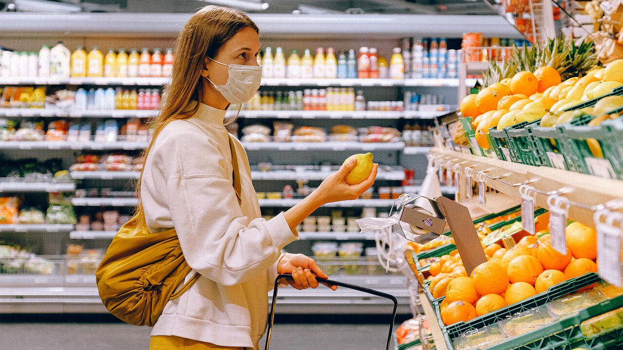 Woman wearing mask grocery shopping