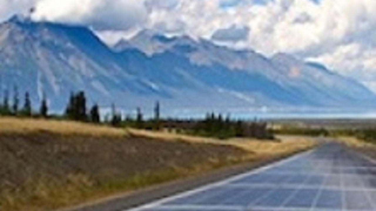 A road paved with solar panels runs to the horizon