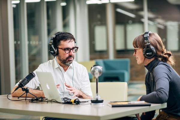 Robert Danisch interviewing woman