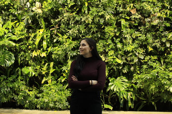 Girl looking to the left with a plant background