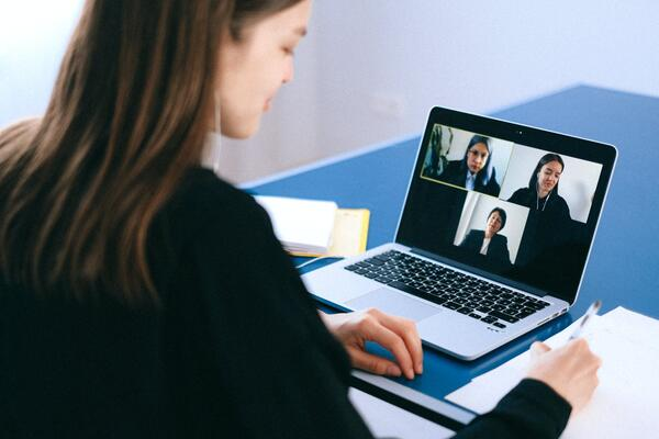 Woman in a virtual meeting on her laptop