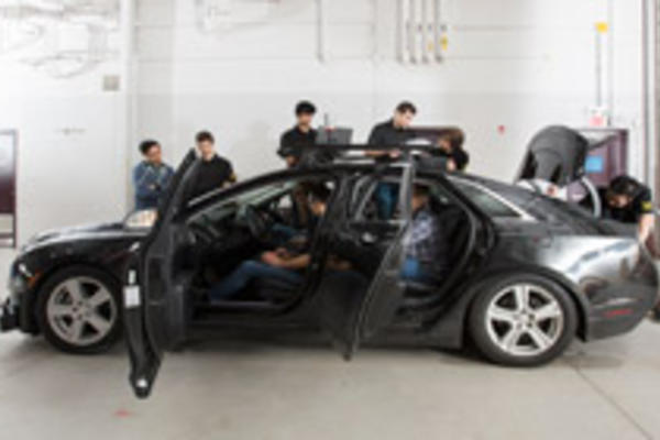 students working on autonomoose car
