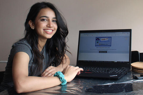Ridhi Patel in front of a laptop