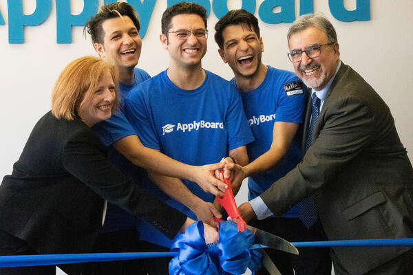 Feridun cutting the ribbon at ApplyBoard
