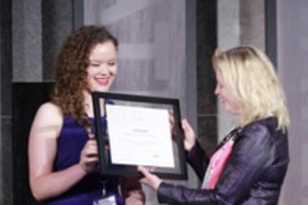Madelaine Liddy receiving her award