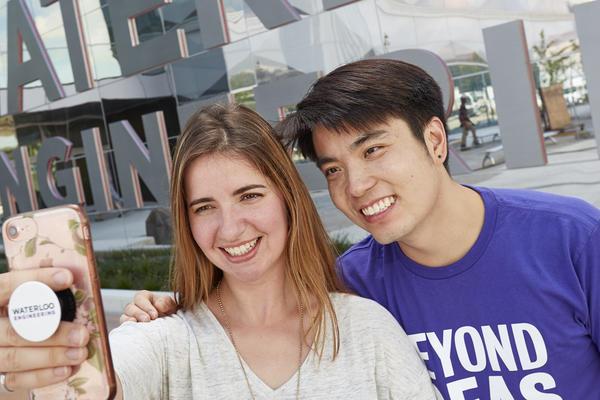Two student taking selfie outside engineering 7