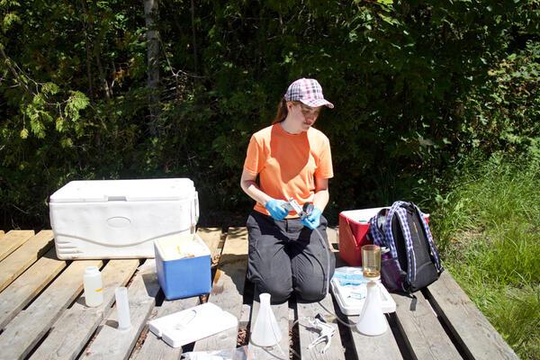 Ellen Cameron collecting water samples