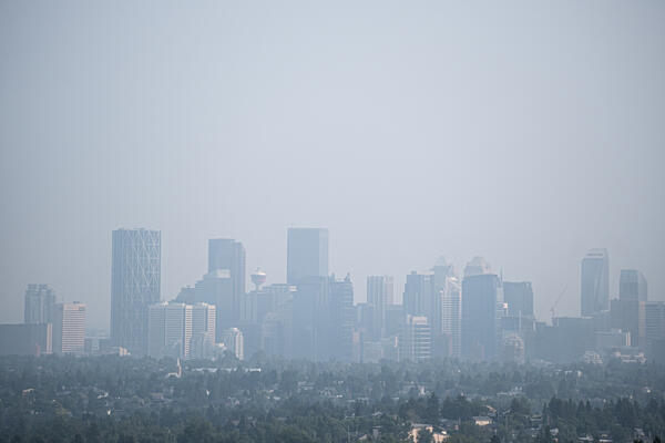 Downtown Calgary city street covered with smoke from forest fires