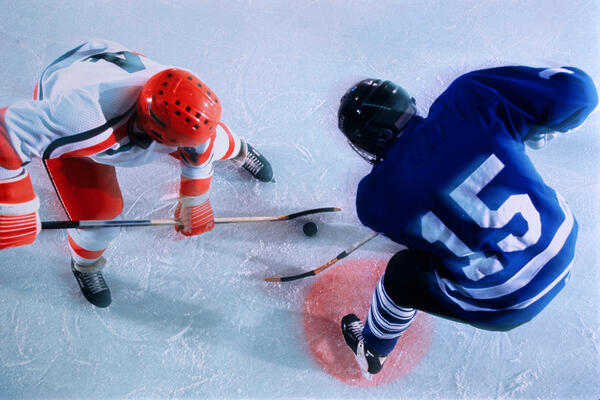 Ice hockey players in face-off