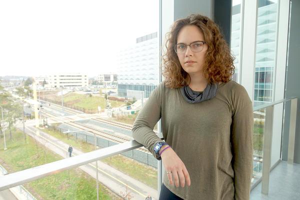 Leah Kristufek standing at window
