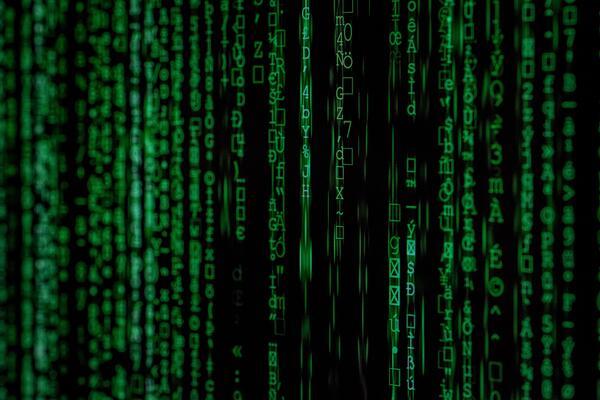 Binary code rushing across screen