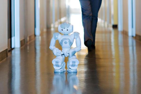 robot walking down the hall
