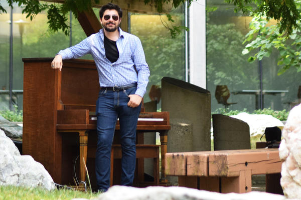 Max standing beside piano