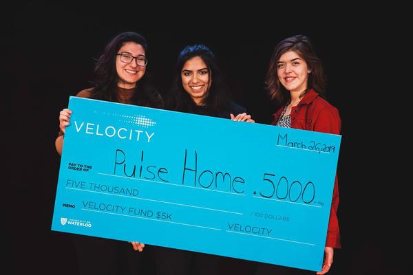 Emman Haider, Paula Przybylski and Sara Turner holding their cheque