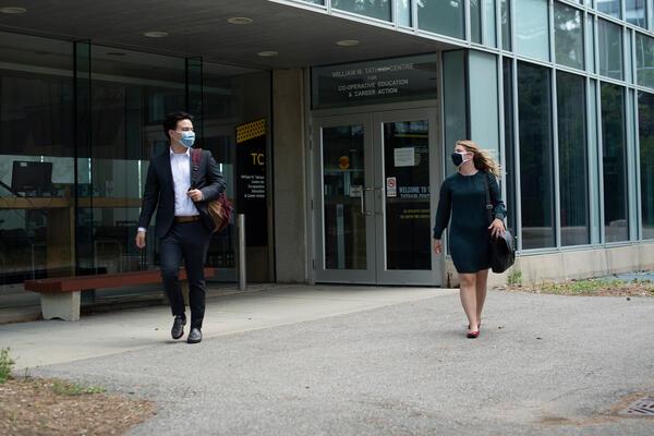 Two students walking outside