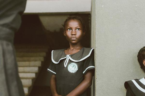 African girl standing in her school uniform