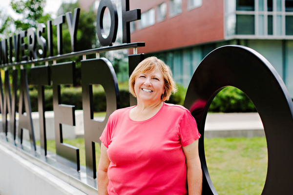 Sharon Lamont stands in front of University of Waterloo sign