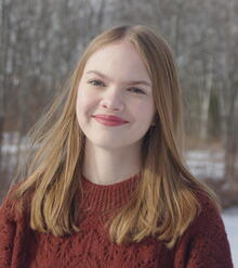 Profile photo of Brianna Thomas with a red sweater and snow in the background