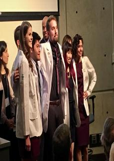 Students at a white coat ceremony