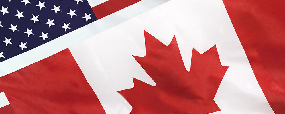 Canadian flag overlaying American flag