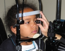 Child receiving eye examination