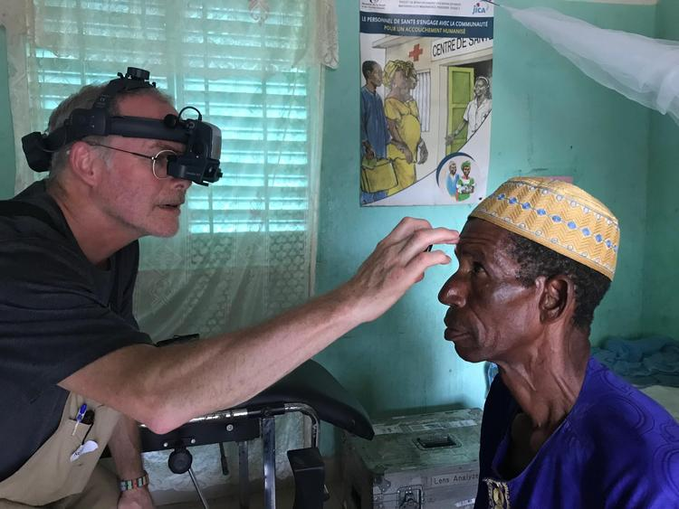 Dr. Neil Paterson completes an eye exam during the clinics