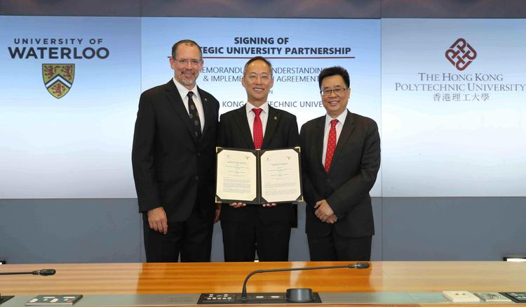 Hong Kong PolyU Vice President (Research Development), Alexander Wai holds witnessed agreement (centre) with Waterloo Dean of Science, Bob Lemieux (left) and PolyU Dean of Health and Social Sciences, David Shum