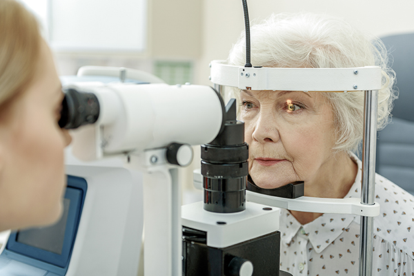 Optometrist performing exam on patient