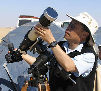 Dr. Ralph Chou sets up one of his eclipse filming cameras