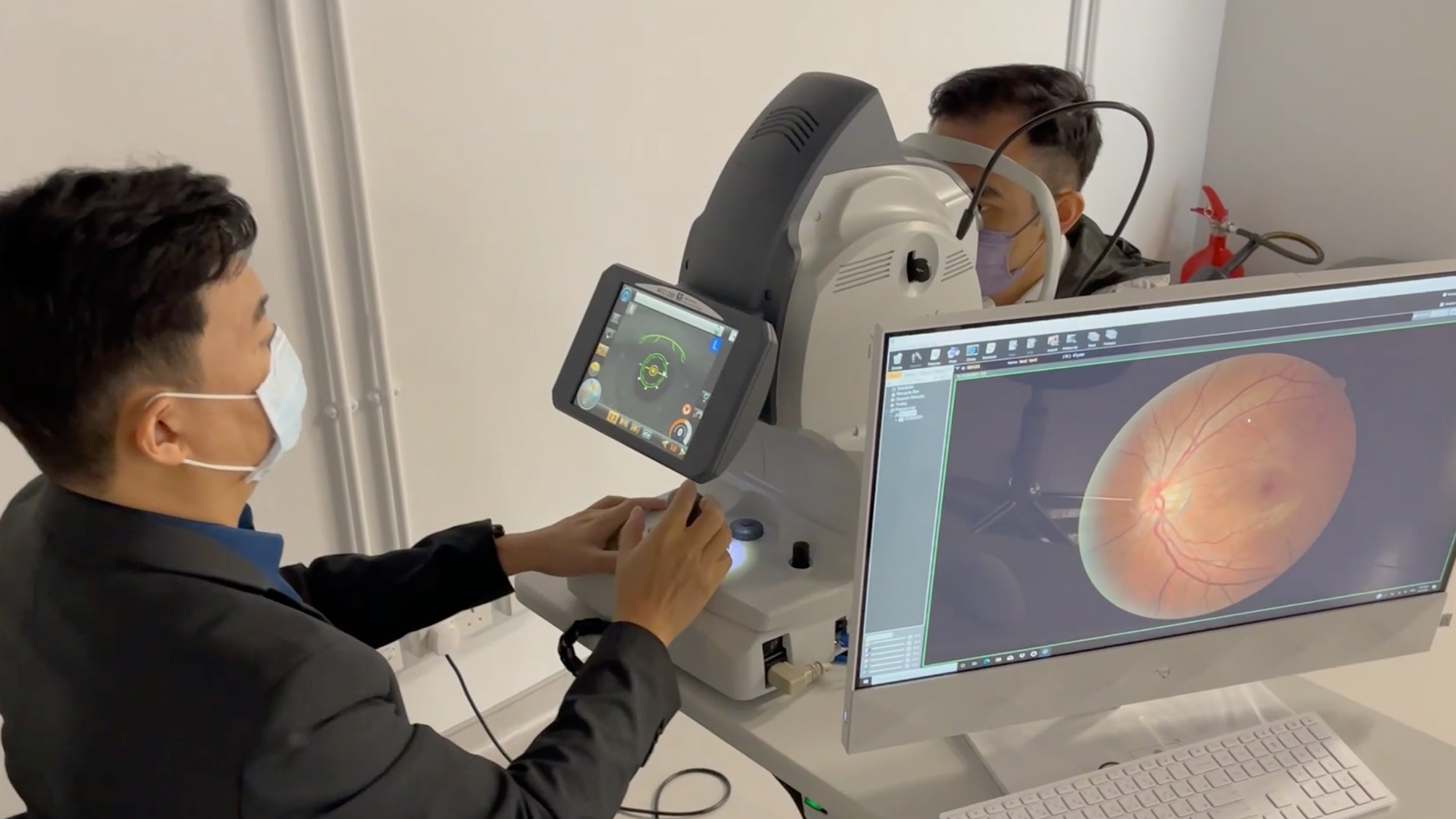 An ophthalmologist imaging the back of a patient's eye