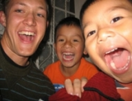 David Neufeld with two boys smiling big for the camera.