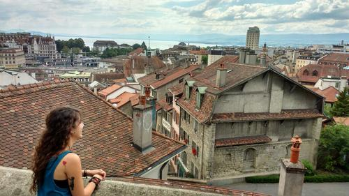 Female student looking out over old european houses