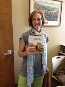 Reina Neufeldt holds a copy of her new book.