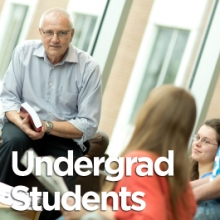 Professor with students (undergraduate students button)