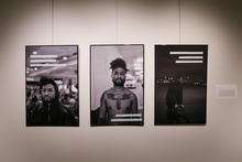 Three framed photographs of a young black man